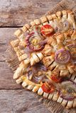 Puff pastry pies with red onions and tomatoes vertical top view Royalty Free Stock Photography