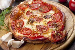 Puff pastry pizza. Margherita with cheese and tomato Royalty Free Stock Photography