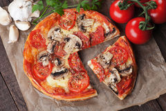 Puff pastry pizza or pie. With mushrooms, tomato and cheese Stock Photos