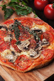 Puff pastry pizza or pie. With mushrooms, tomato and cheese Royalty Free Stock Photo