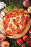 Puff pastry pizza or pie. With tomato and cheese Stock Photos