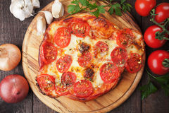 Puff pastry pizza. Or pie with tomato and cheese Stock Images