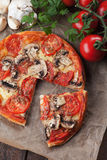 Puff pastry pizza or pie. Wit tomato, cheese and mushrooms Royalty Free Stock Image
