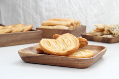 Puff Pastry. Is placed in a wooden plate on white table Stock Photo