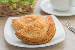 Puff pastry on plate and coffee cup Stock Photos