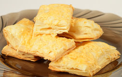 Puff pastry on the plate. Sweet puff pastry on the plate Royalty Free Stock Photo