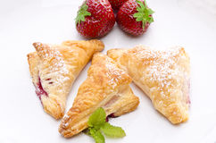 Puff pastry pockets with strawberry Stock Image