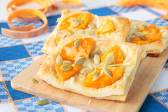 Puff pastry with pumpkin, garlic and cheese Royalty Free Stock Photos