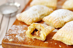 Puff pastry ravioli with chocolate caramel filling Stock Photos