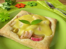 Puff pastry with rhubarb. Blancmange and pineapple-scented sage royalty free stock image