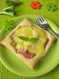 Puff pastry with rhubarb. Blancmange and pineapple-scented sage stock image