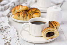 Puff pastry rolls with chocolate and coffee cup Stock Images