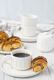 Puff pastry rolls with chocolate and coffee cup Royalty Free Stock Image
