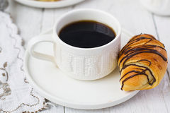 Puff pastry rolls with chocolate and coffee cup Royalty Free Stock Photo