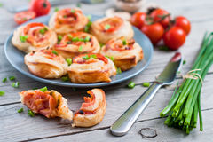 Puff pastry rolls with ham and chese. Baked snacks Stock Photos