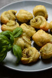 Puff pastry rolls with italian pesto filling Stock Photo