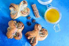 Puff pastry rolls with poppy and honey. Stock Photos