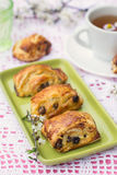 Puff pastry rolls with raisins and cream cheese Royalty Free Stock Image