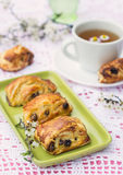 Puff pastry rolls with raisins and cream cheese Stock Image