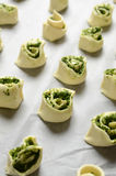 Puff pastry rolls with spinach and greek cheese filling Stock Photo