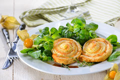 Puff pastry with salmon on salad Stock Photo