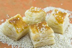Puff pastry with sesame on orange background with sesame seeds Stock Photos