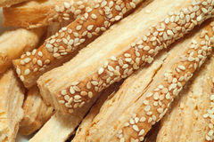 Puff pastry with sesame seeds. Extremely closeup tasty puff pastry with sesame seeds Stock Image