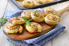 Puff pastry snack with ham. Baked hearty puff pastry rolls with ham, cream cheese, parmesan and herbs Royalty Free Stock Images