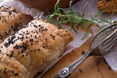 Puff pastry with spinach filling and black cumin Royalty Free Stock Images