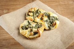 Puff pastry with spinach. Puff pastry ravioli with spinach and chicken Stock Image