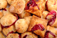 Puff pastry with strawberry cherry jam filling. Puff pastry with strawberry and cherry jam filling Stock Image