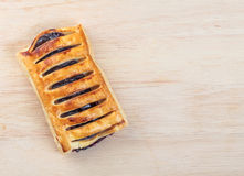 Puff pastry stuffed  with Blueberry jam. On tray wood Royalty Free Stock Photos