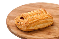 Puff pastry stuffed with hot dog on the wooden board Royalty Free Stock Photography