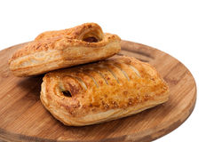 Puff pastry stuffed with hot dog on the wooden board Royalty Free Stock Photo