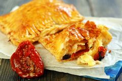 Puff pastry with sun-dried tomatoes and cheese Royalty Free Stock Photography