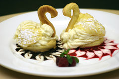 Puff Pastry Swans. A Valentines Day Dessert - Two Puff Pastry Swans royalty free stock images