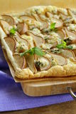 Puff pastry tart with blue cheese Stock Photos