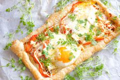 Puff  pastry tart with egg and bacon Stock Photos