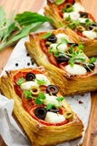Puff pastry with tomatoes and mozzarella Stock Photography