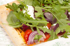 Puff pastry with tomatos onions rocket salad and goats cheese Stock Photos
