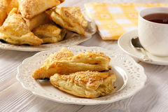 Puff pastry triangles filled with feta cheese and leek. Royalty Free Stock Photo