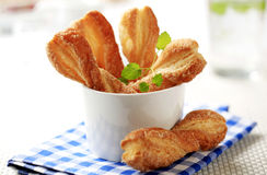 Puff pastry twists. Sprinkled with sugar Stock Photography