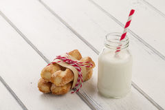 Puff pastry twists sprinkled and milk Stock Images