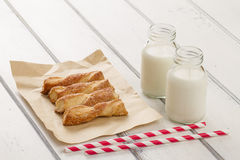 Puff pastry twists sprinkled with sugar Stock Images