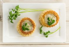 Puff pastry vol-au-vents filled with mushroom ragout Stock Photos