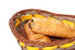Puff pastry in the wicker basket over white background Stock Photography