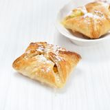 Puff pastry. On the wooden white table Royalty Free Stock Image