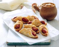 Puff pastry wrapped mini sausages royalty free stock image