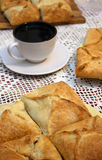 Puff pie and cup of tea. Puff pies and cup of tea on the needlepoint napkin Stock Photos