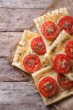Puff pie with tomato and cheese close-up vertical. top view Royalty Free Stock Photo